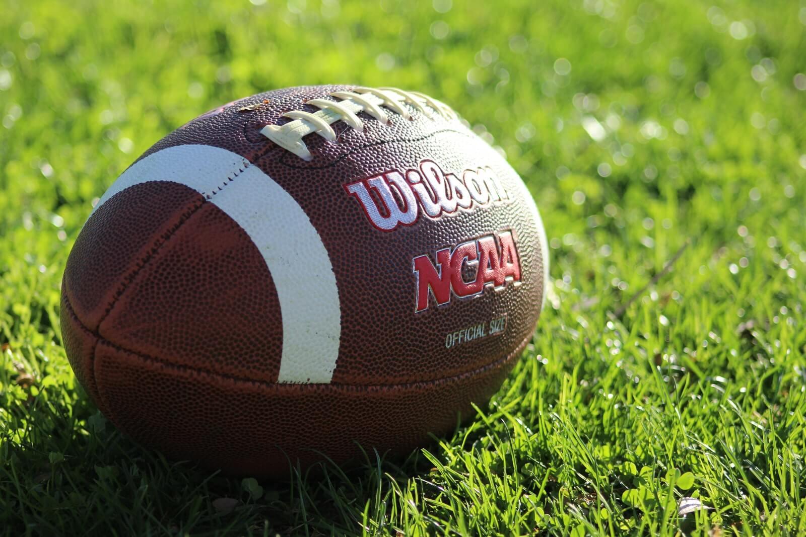 football with ncaa logo